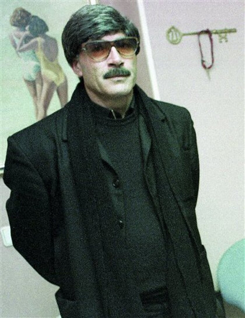 "In this undated photo released on Friday, Dec. 24, 2010, shows Francisco Holgado, better known as ""Father Courage,"" in his disguised at his home in Jerez de la Frontera, southern Spain.  Francisco Holgado's son Juan Holgado was working as a night shift gas station clerk on Nov. 22, 1995 when he was"