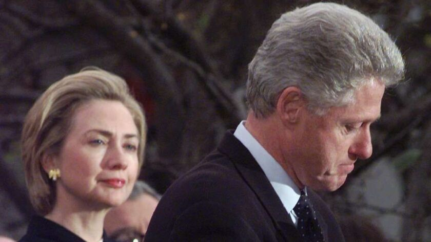 President Clinton makes a statement as first lady Hillary Rodham Clinton looks on at the White House.