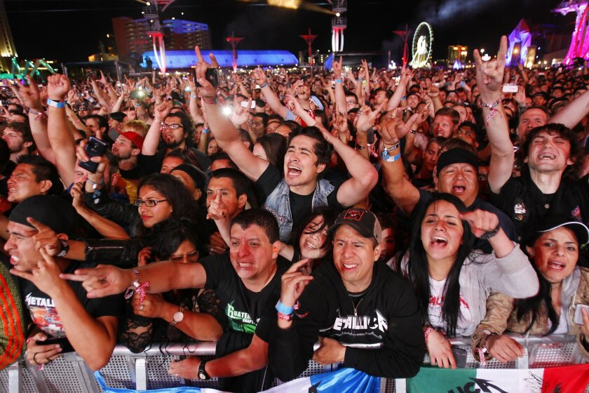 Fans cheer for Metallica on day 2 of the Rock in Rio USA music festival in Las Vegas.