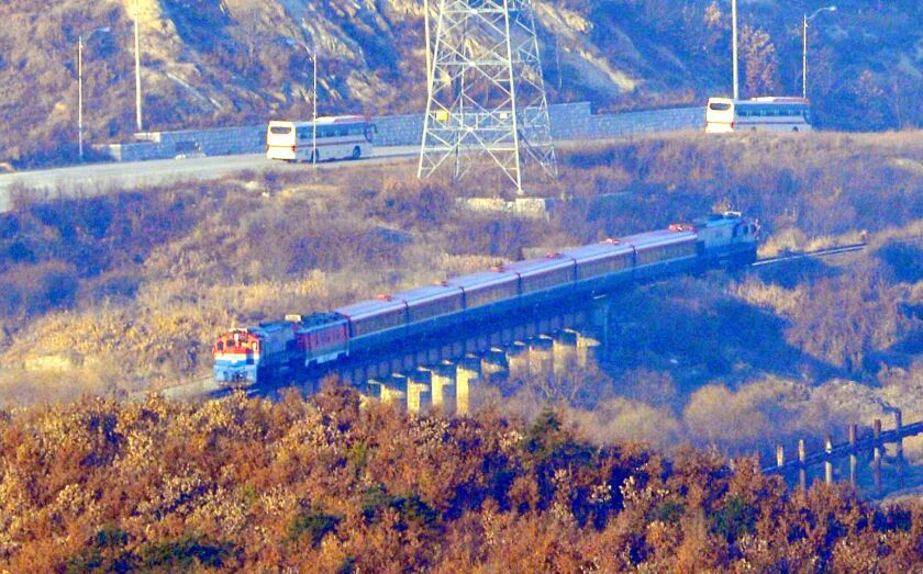 A train carries a South Korean delegation to the North Korean border town of Kaesong on Wednesday for the ceremonial launch of a project to link railways and roads.