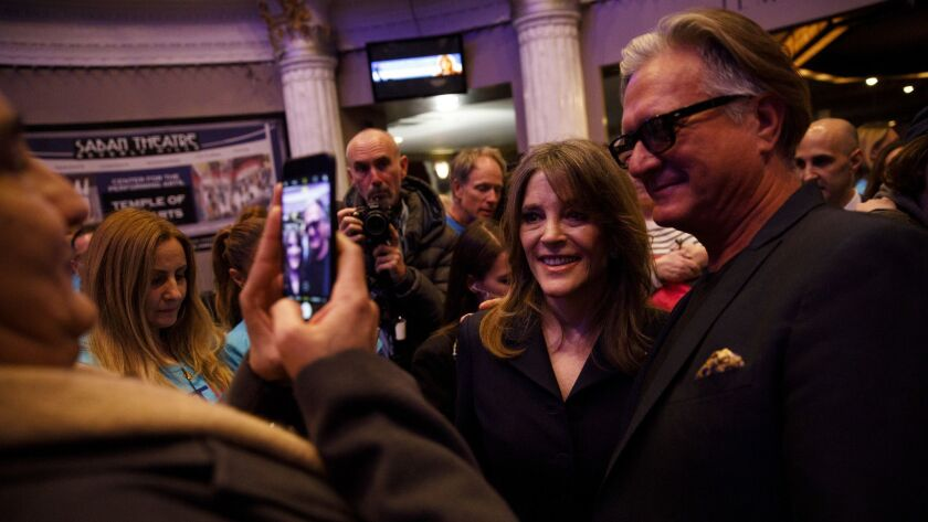 Author Marianne Williamson is greeted by supporters after the announcement of her presidential campa