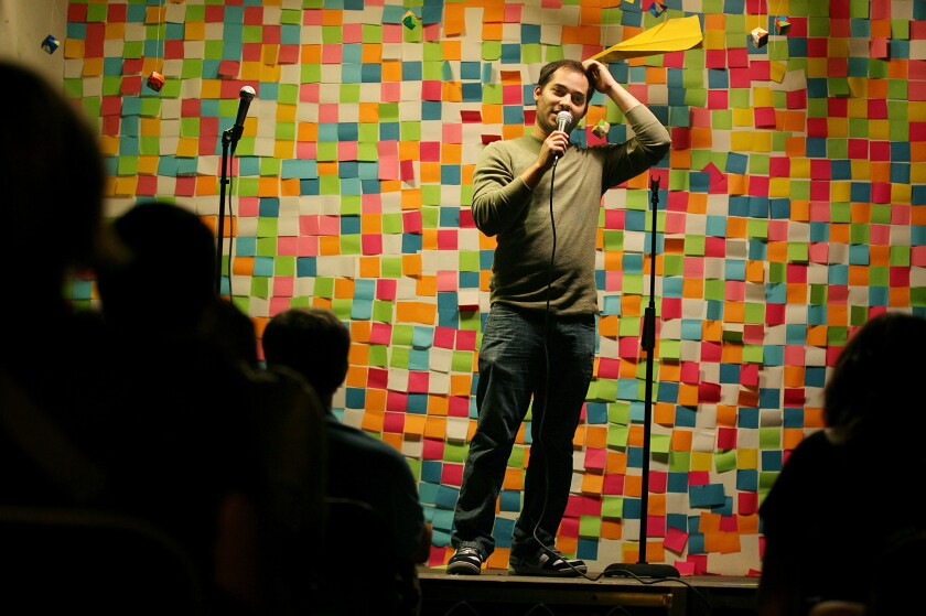 Comic writer Harris Wittels, shown performing during a charity event in July 2009, was found dead Thursday at his home in Los Angeles.