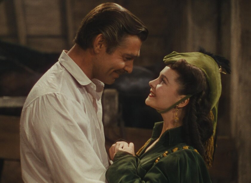 "This photo provided by Warner Bros. Home Entertainment shows Clark Gable, left, as Rhett Butler, and Vivien Leigh as Scarlett O'Hara in a scene from the film, ""Gone With the Wind."" The film's 75th anniversary will be celebrated over the next week, with special screenings and Warner Bros. Home Entertainment's release of a lavish new limited-edition box set. (AP Photo/Warner Bros. Home Entertainment)"