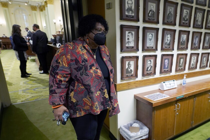 Democratic Assemblywoman Shirley Weber leaves the Assembly Chambers.