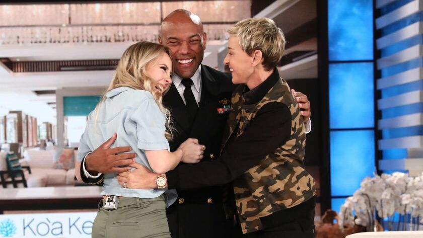 "San Diegans Maura Gonsalves, left, and her boyfriend, Noah Copeland, join Ellen on ""The Ellen DeGeneres Show"" on Jan. 25 in Burbank. The couple gave their vacation savings to hurricane victims in Puerto Rico."