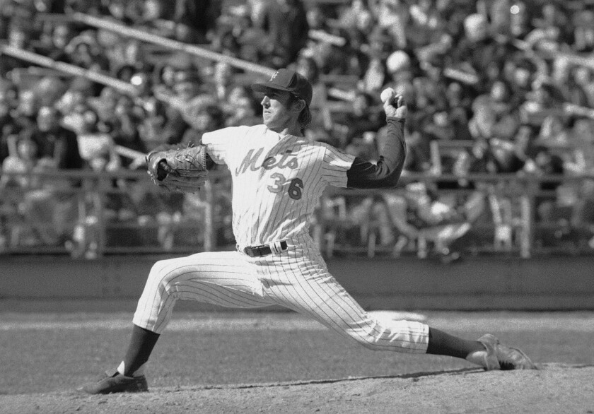 FILE - In this April 10, 1974, photo, New York Mets' Jerry Koosman pitches to a St. Louis Cardinals batter during the fifth inning of a baseball game at Shea Stadium in New York. Koosman will become the third Mets player to have his number retired by the team. The popular left-hander will be honored sometime next season, with his No. 36 joining Tom Seaver's No. 41 and Mike Piazza's No. 31 on display along the Citi Field roof. (AP Photo/Ray Stubblebine, File)