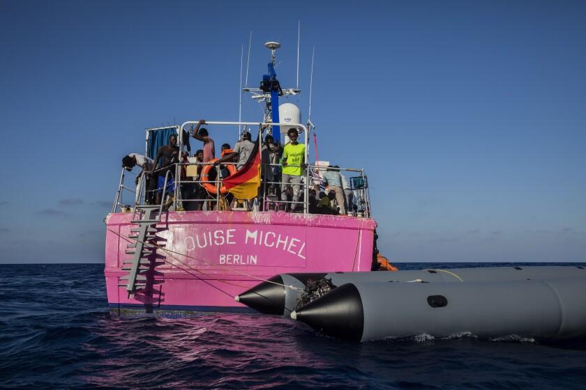 Migrants aboard a rescue vessel sponsored by the artist Banksy in the Mediterranean Sea.