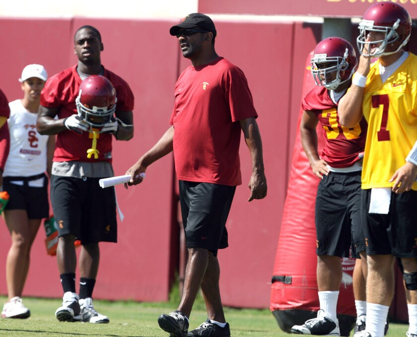 Former USC running backs coach Todd McNair takes part in Trojans' practice in 2009.