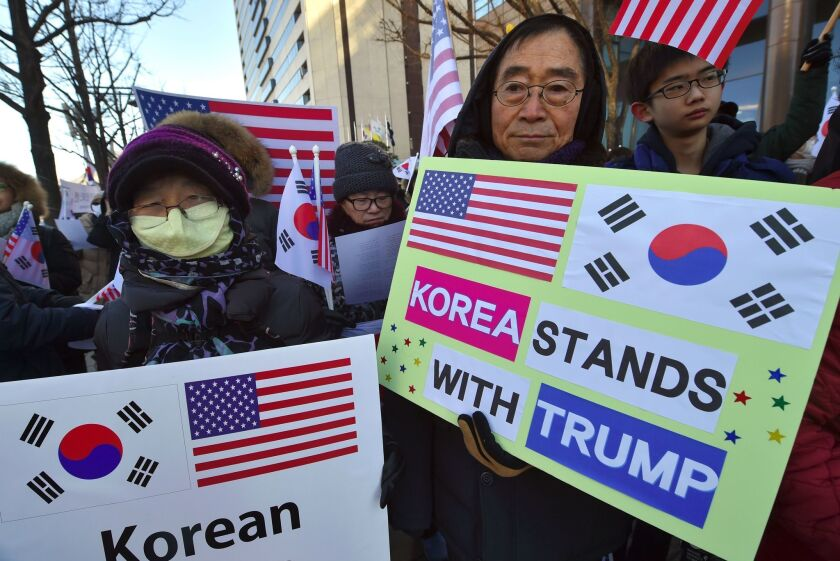 South Korean Christians hold placards during a rally Feb. 2 in Seoul to welcome the visit of Defense Secretary James Mattis.