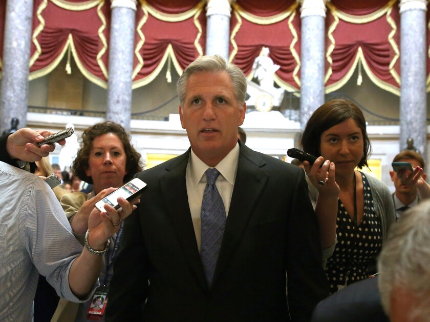 Rep. Kevin McCarthy is trailed by reporters while walking in the U.S. Capitol building Wednesday. McCarthy, the leading contender for House majority leader, opposes California's bullet train project.