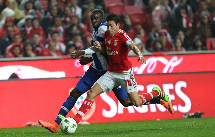Benfica's Nico Gaitan, right, fights for the ball with Porto's Moussa Marega during their Portuguese league soccer match at Benfica's Luz stadium in Lisbon, Friday, Feb. 12, 2016. (Armando Franca)