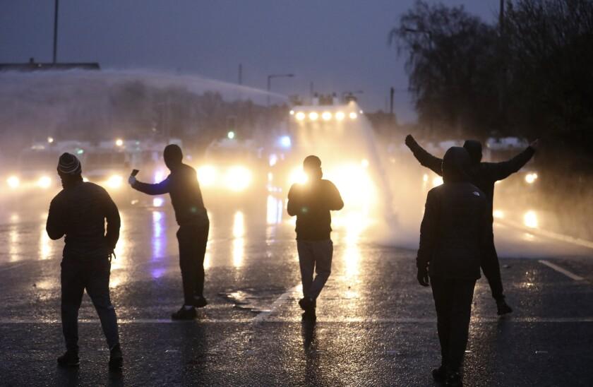 Youths in the dark in Belfast, Northern Ireland