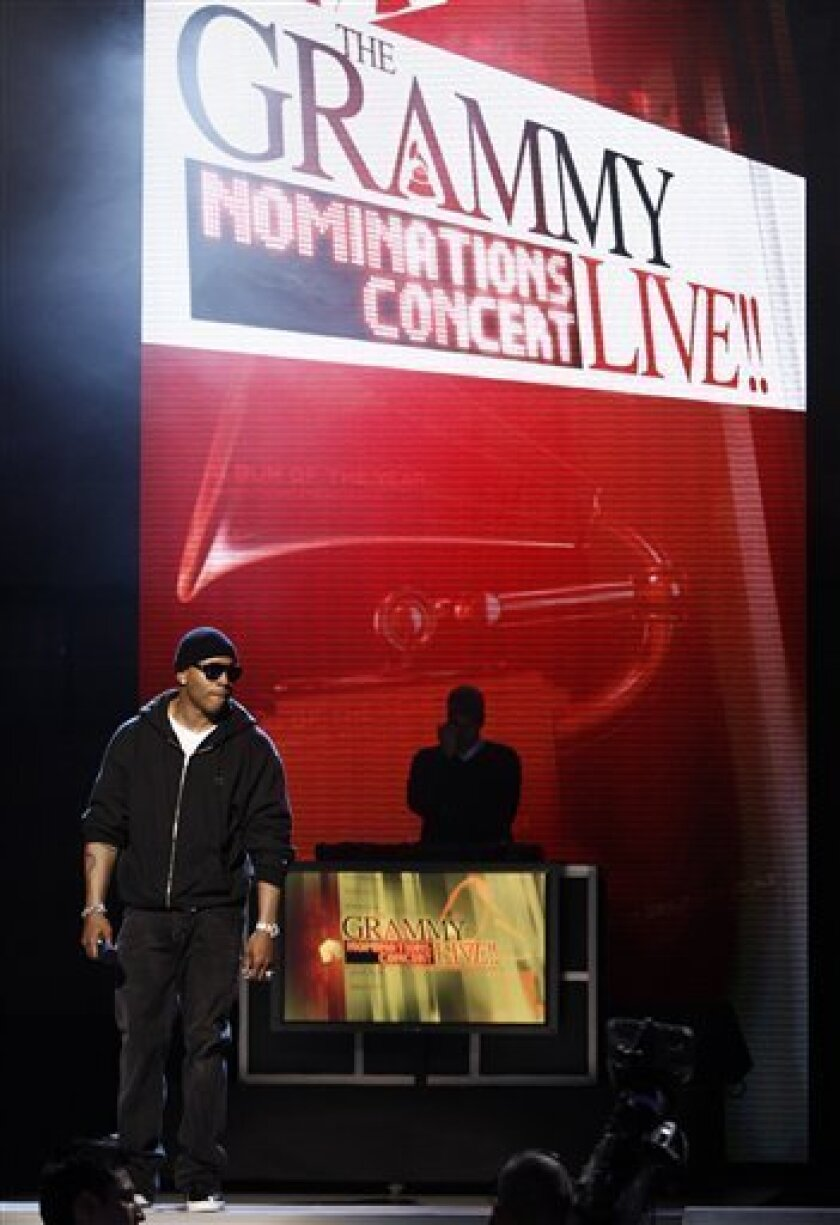 Host LL Cool J is seen while rehearsing a segment for the Grammy Nominations Concert Live in Los Angeles on Tuesday, Dec. 1, 2009. The Grammy Nominations Live Concert will take place Wednesday, Dec. 2 in Los Angeles. (AP Photo/Matt Sayles)