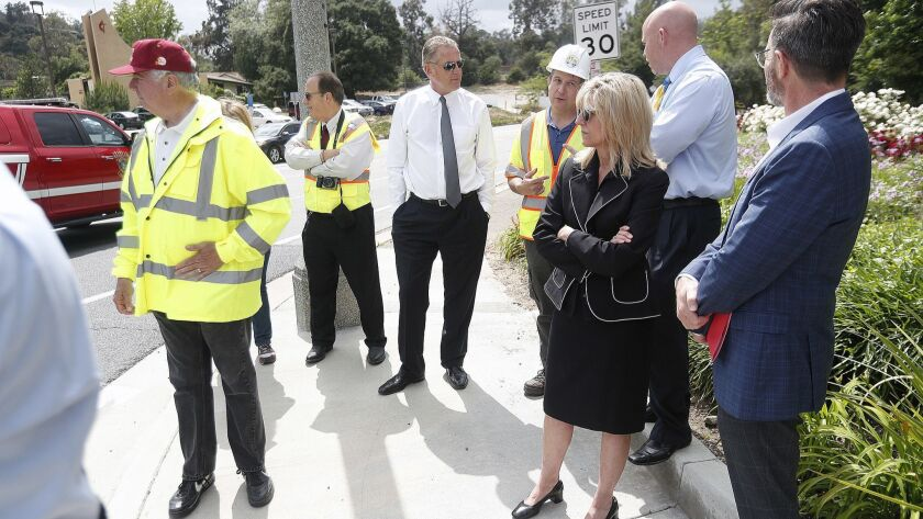 La Canada council members and school board watch the corner of Berkshire Place and Oak Grove Drive i