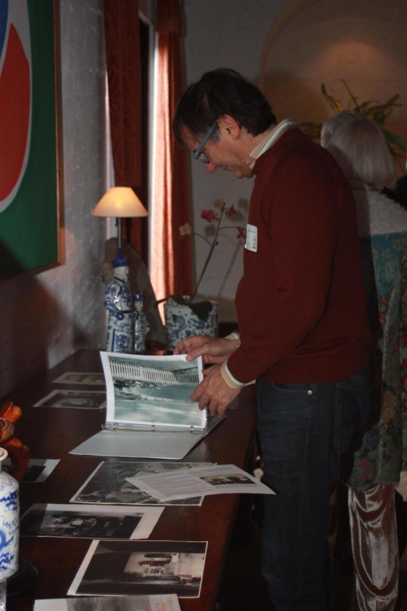 Alessandro Sette looks at old photos of the house at the reception.
