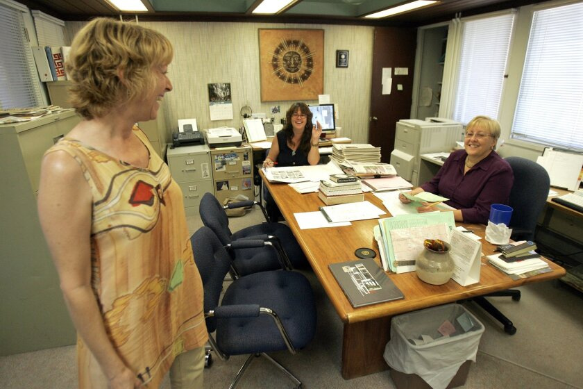 Borrego Sun Editor Judy Winter Meier, right, is shown in her newspaper office in 2008 talking to reporter Connie George, right, and layout artist Ellen Fitzpatrick.