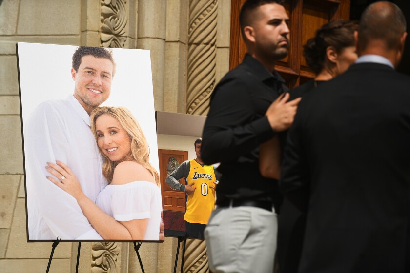 A photo of Angels pitcher Tyler Skaggs and his wife, Carli, is displayed outside St. Monica Catholic Church during the Angels pitcher's memorial service on Monday.