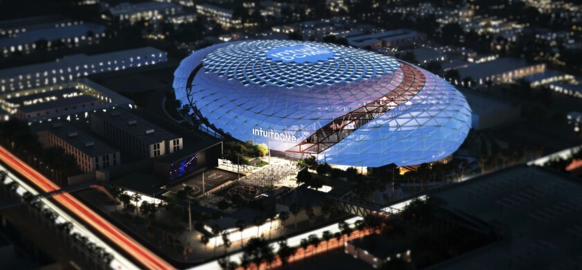 An artist's rendering shows an aerial view of the Clippers' new arena, the Intuit Dome, at night.