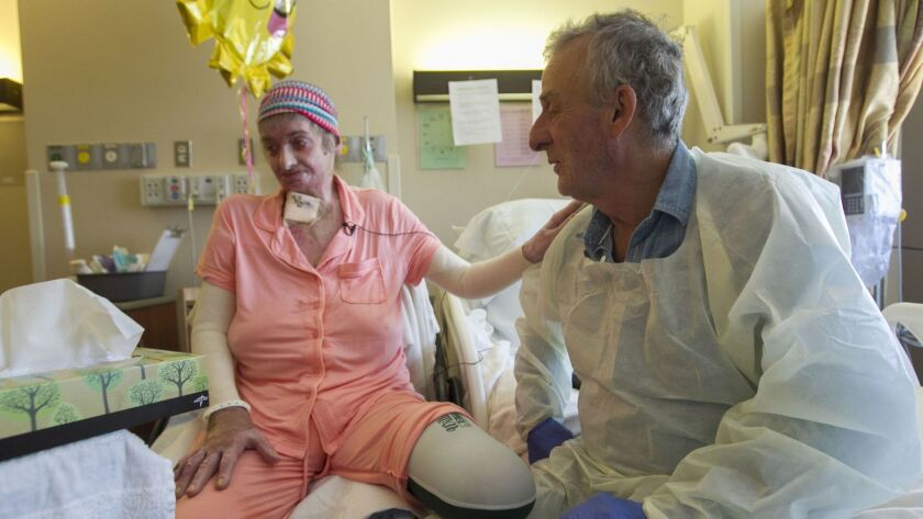 Martine Bellocq and husband Pierre Bellocq are shown about three months ago during Martine's recovery after being burned in last year's fire at San Luis Rey Downs.