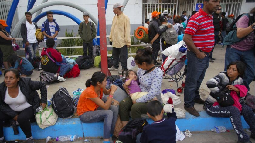 Families with young children waited outside the temporary shelter set up at the Unidad Deportiva Benito Juarez, a municipal gym in Tijuana, hoping to get in for the evening.