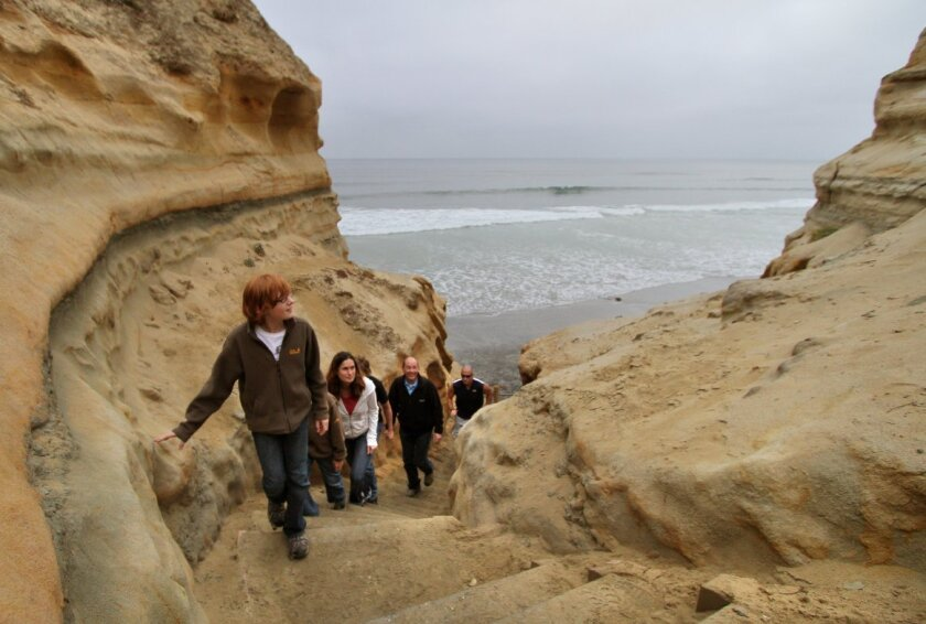 Benedict Algermissen, here with family from Germany visiting friends in San Diego leads his group up the steep Beach Trail from the beach below at Torrey Pines State Natural Reserve.