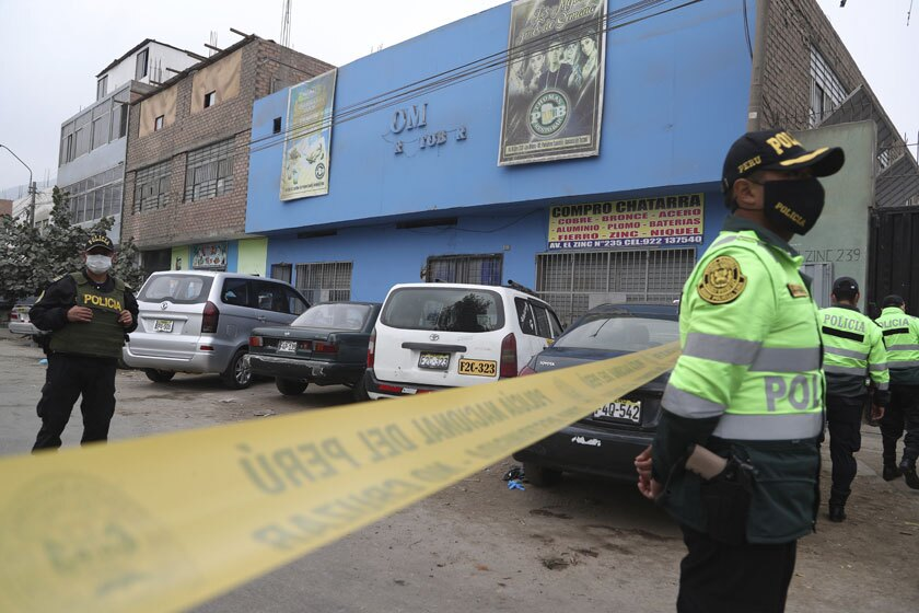 Police officers outside the Thomas disco in Lima, Peru, where officials said 13 died in a stampede.