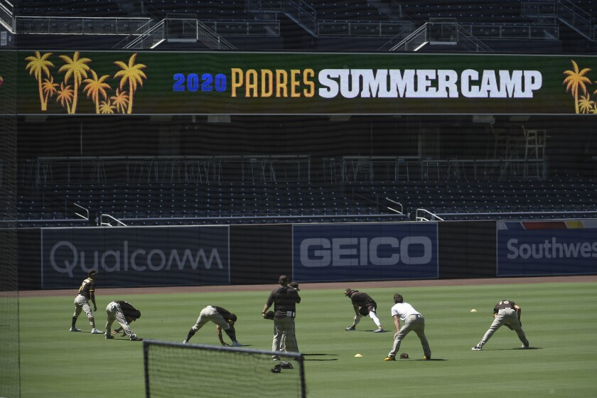 San Diego players warm up on the field during Padres first workout of Summer Camp Friday, July 3, 2020 in at Petco Park in San Diego. (Photo by Denis Poroy)
