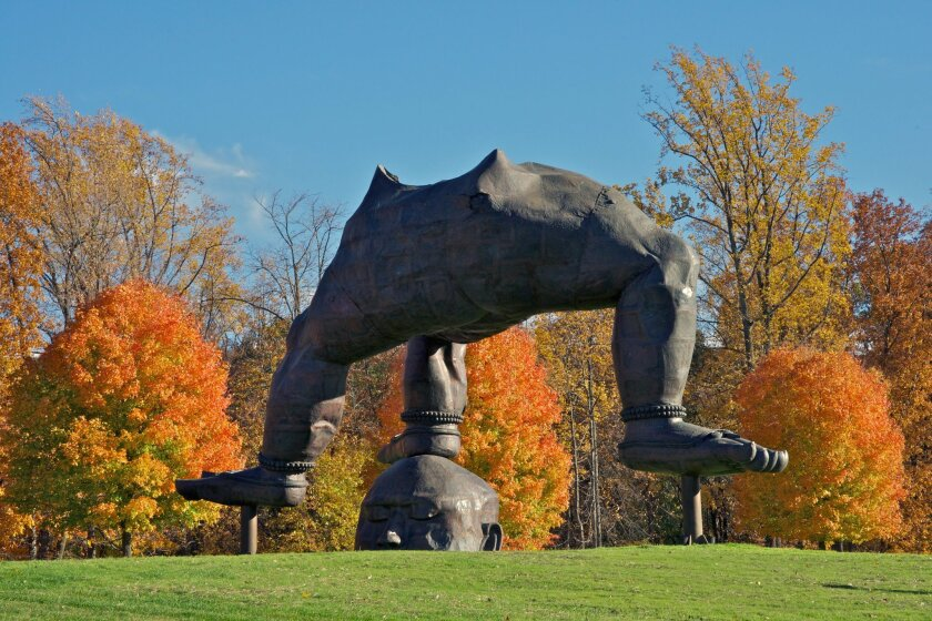 """This undated image provided by Storm King Art Center in New Windsor, N.Y., shows """"Three-Legged Buddha"""" by Zhang Huan, one of more than 100 outdoor sculptures at the unique art park set amid rolling hills and fields in the Hudson Valley, just north of New York City. It's one of a number of destinati"""