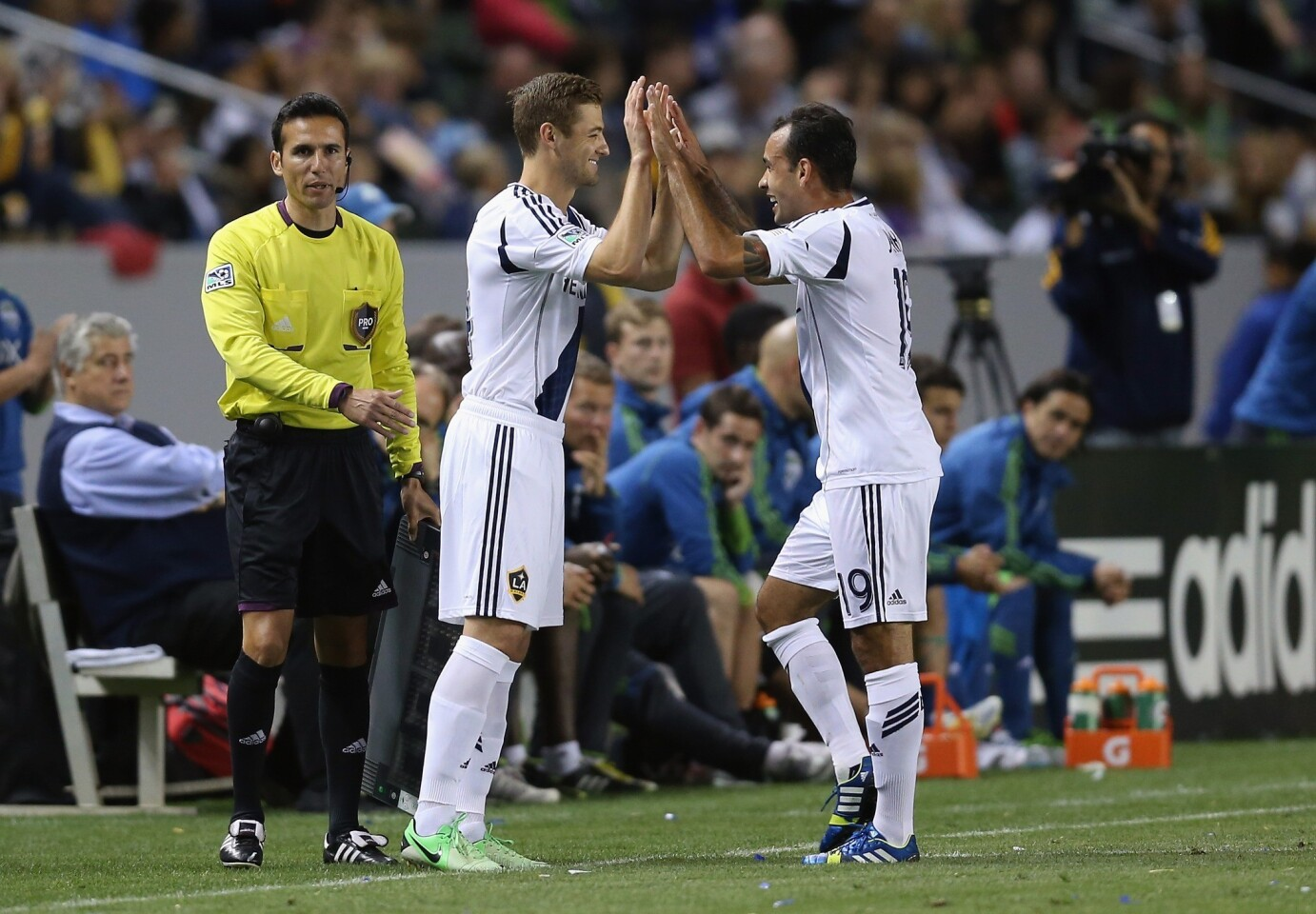 Midfielder Robbie Rogers, entering the game for teammate Juninho in the 77th minute Sunday night, became the first openly gay male athlete in a major U.S. sports league when he made his debut for the Galaxy on Sunday night in a 4-0 victory over the Seattle Sounders.