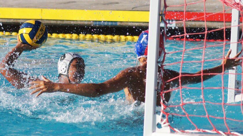 Poway High's Garrett Duardo files on goal during a recent water polo match.