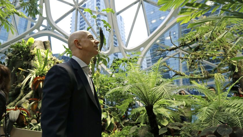 Jeff Bezos, the CEO and founder of Amazon.com, takes a walking tour of the Amazon Spheres, three plant-filed geodesic domes that serve as a work and gathering place for Amazon employees in Seattle.