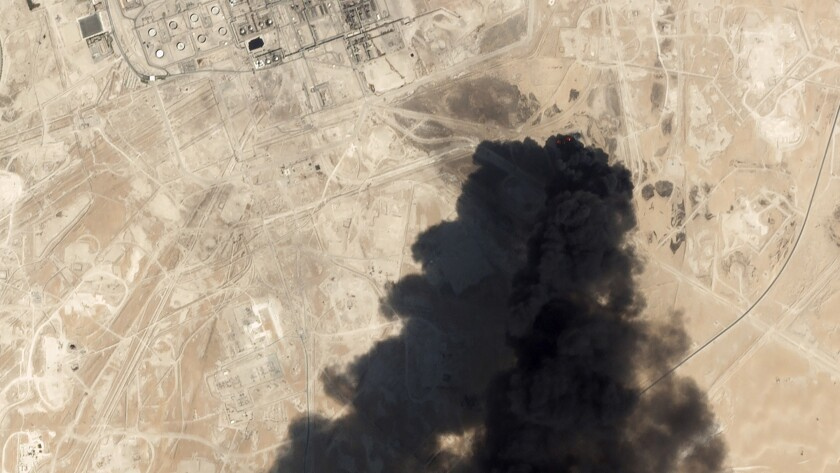 This satellite image from Planet Labs Inc. shows thick black smoke rising from Saudi Aramco's Abqaiq oil processing facility on Saturday in Buqyaq, Saudi Arabia.