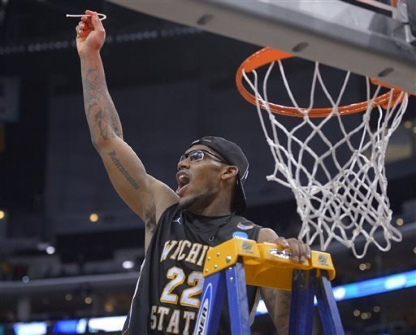 Wichita State's Carl Hall celebrates after his team defeated Ohio State 70-66 in the West Regional final in the NCAA men's college basketball tournament, Saturday, March 30, 2013, in Los Angeles. (AP Photo/Mark J. Terrill)