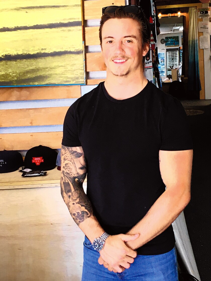 """Colby Bruno — an employee at Bird Rock Surf Shop, which is located near a roundabout on La Jolla Boulevard — observes: """"People don't know how to use it. There's a lot of honking and upraised arms."""""""