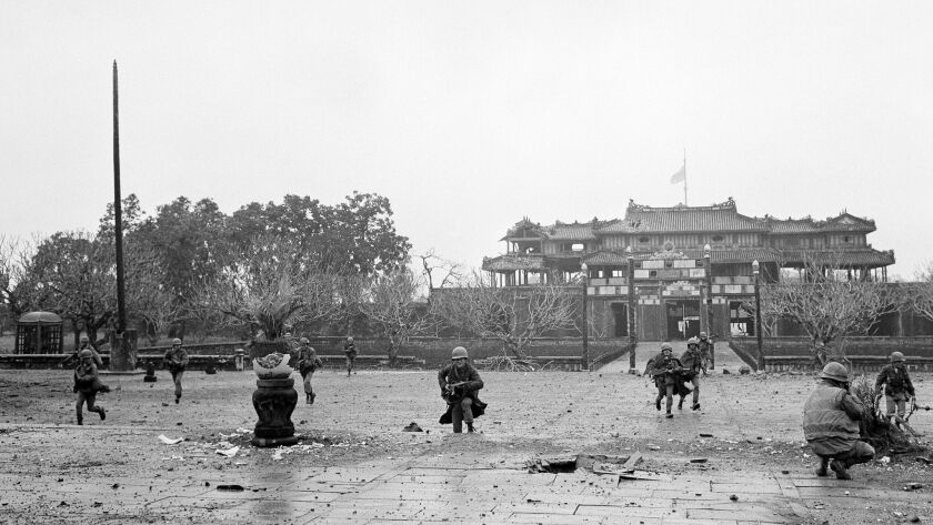 U.S. Marines and Vietnamese troops move through the grounds of the Imperial Palace in the old citade
