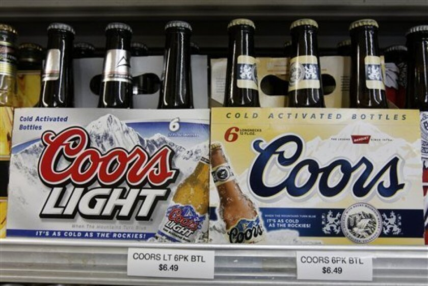 Coors beers are seen on display at JJ&F Market in in Palo Alto, Calif., Monday, Feb. 9, 2009. Molson Coors Brewing and SABMiller said Tuesday fourth-quarter profit for their joint venture MillerCoors declined 40 percent mainly due to hefty impairment charges related to its Sparks brand and costs to integrate the two companies' beer brands in the U.S. (AP Photo/Paul Sakuma)