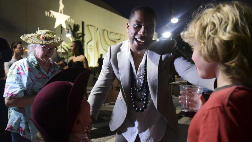 Leslie Odom Jr., the actor that plays the role of Aaron Burr greets people at the entrance plaza of