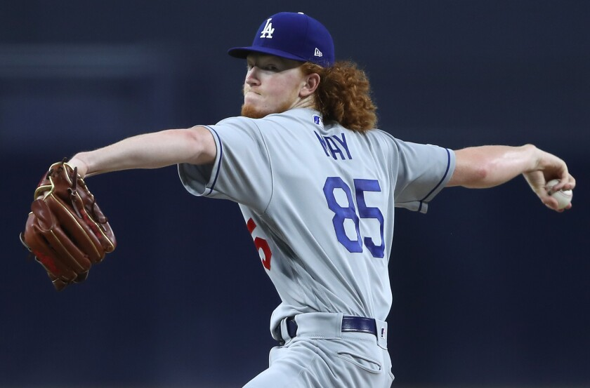 Dodgers pitcher Dustin May delivers against the Padres.