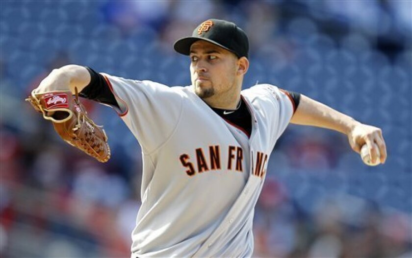San Francisco Giants starting pitcher Jonathan Sanchez throws the ball during the first inning of an MLB baseball game against the Washington Nationals, Saturday, April 30, 2011 in Washington. (AP Photo/Luis M. Alvarez)