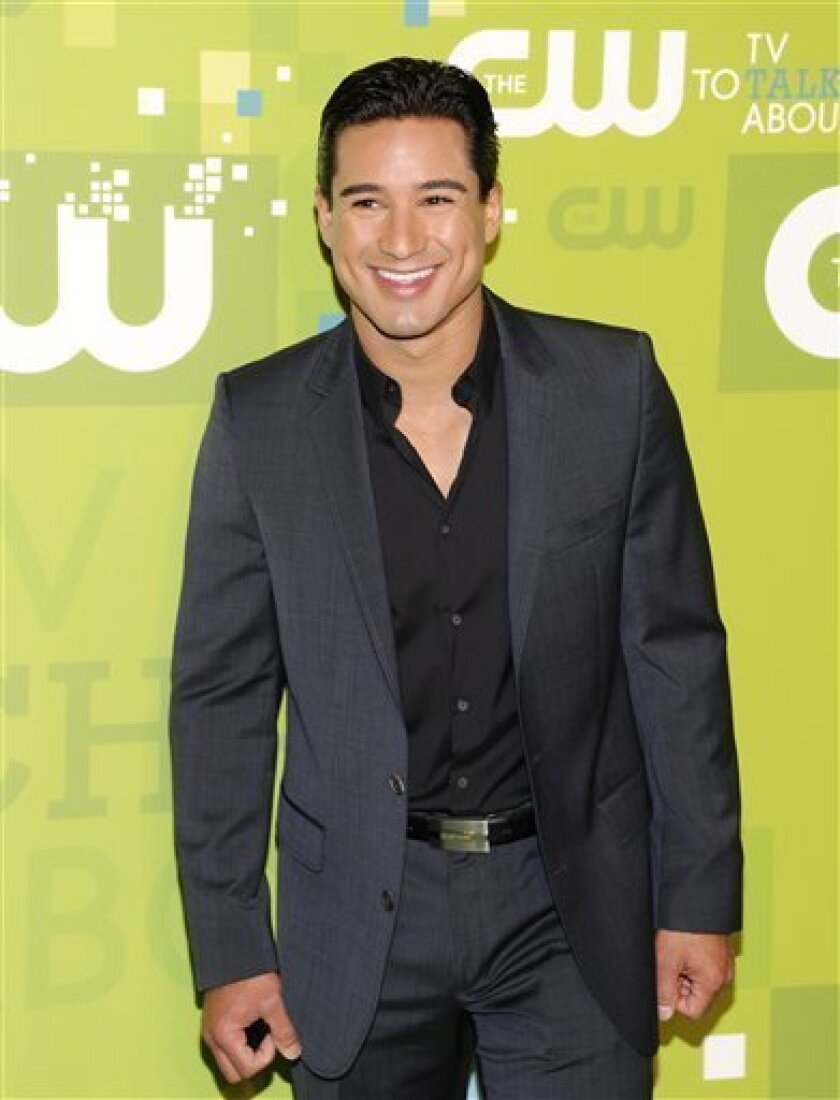 """FILE - In this May 19, 2011 file photo, TV personality Mario Lopez attends The CW Network Upfront 2011 at Jazz at Lincoln Center in New York. Celebra Children's Books announced Thursday, July 7, that Lopez's new book, """"Mario and Baby Gia,"""" will come out Sept. 27. (AP Photo/Evan Agostini, file)"""