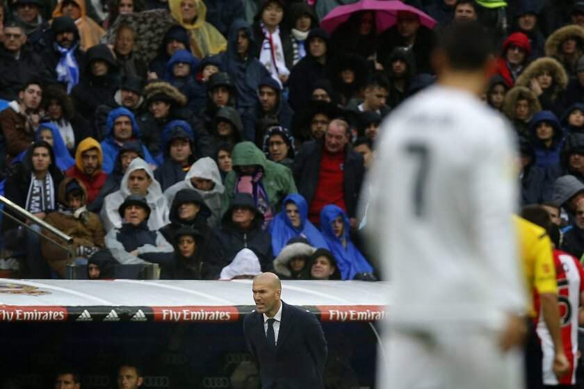Real Madrid's headcoach Zinedine Zidane, center, reacts during a La Liga soccer match between Real Madrid and Athtletic Bilbao at the Santiago Bernabeu stadium in Madrid, Spain, Saturday, Feb. 13, 2016. (AP Photo/Daniel Ochoa de Olza)