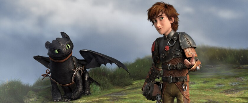 """Toothless, left, and Hiccup in the movie """"How To Train Your Dragon 2."""""""