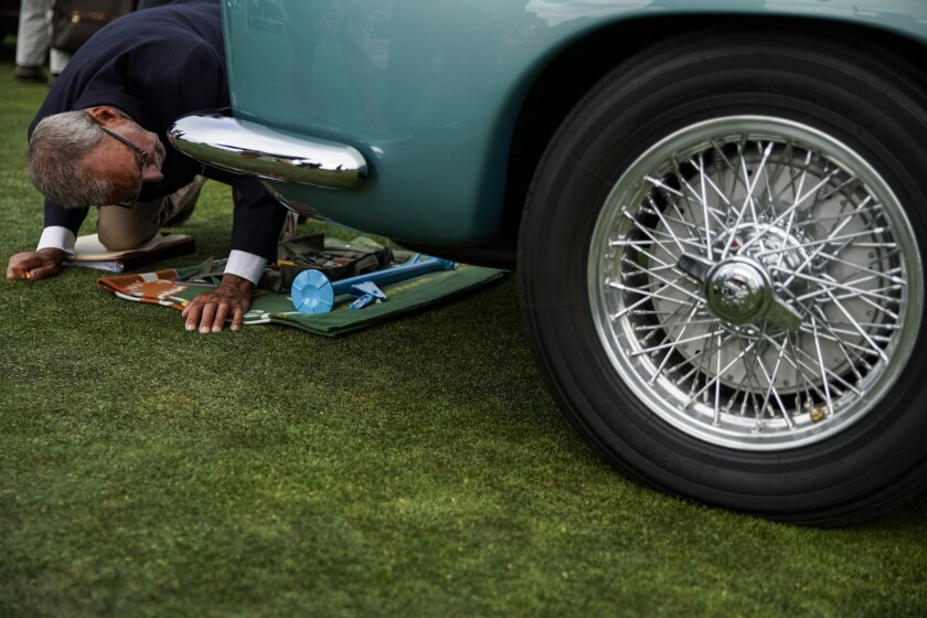 Judge Ron Hein inspects a car at the 69th Pebble Beach Concours d'Elegance
