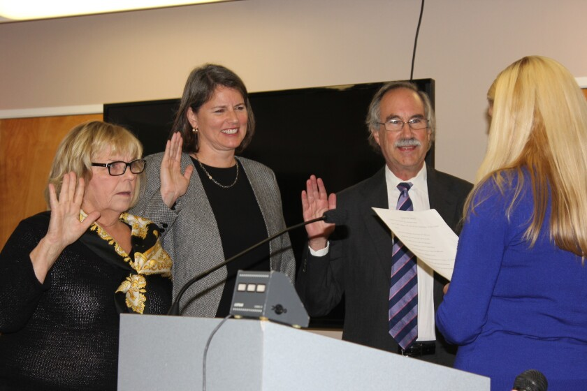 Del Mar City Council members Sherryl Parks, Ellie Haviland and Dave Druker take the oath of office, given by Ashley Jones, administrative services director.