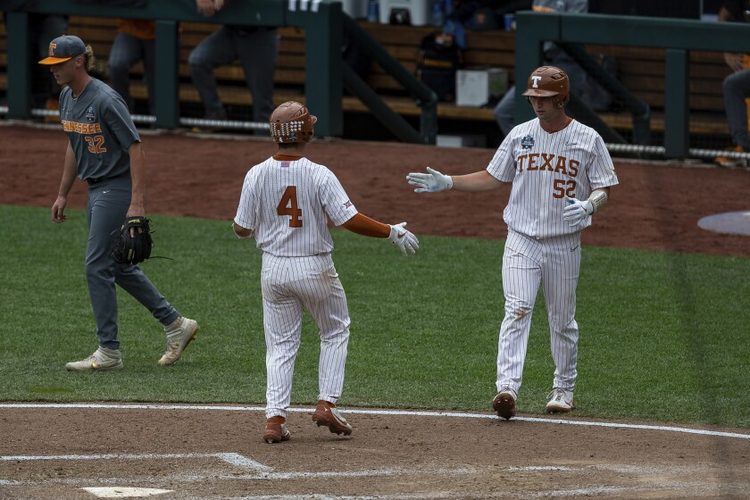 Texas Silas Ardoin (4) scored on a single in the fourth inning against Tennessee during an NCAA college baseball game in the College World Series Tuesday, June 22, 2021, at TD Ameritrade Park in Omaha, Neb. (AP Photo/John Peterson)