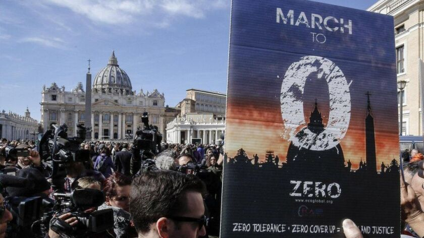 Activists from the Ending Clergy Abuse organization protest in St. Peter's Square in the Vatican on Feb. 24.
