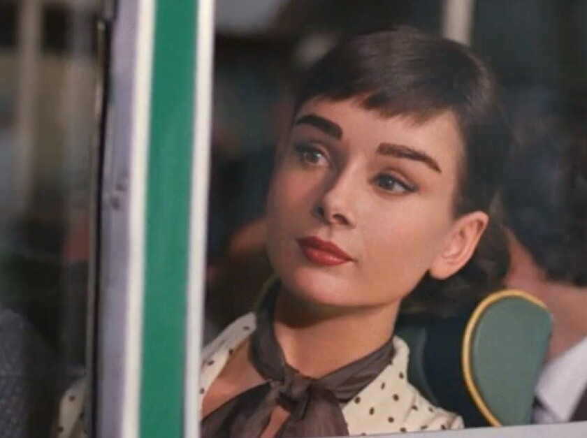 Not available for personal appearances: CGI Audrey Hepburn, in the Dove Chocolate commercial.