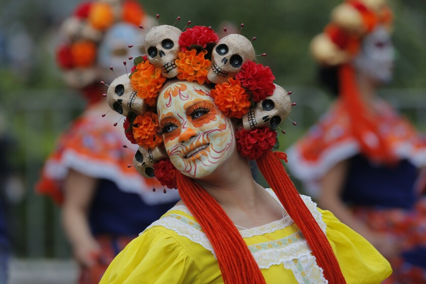 Performers participate in the Day of the Dead parade in Mexico City, Saturday, Nov. 2, 2019. (AP Photo/Ginnette Riquelme)