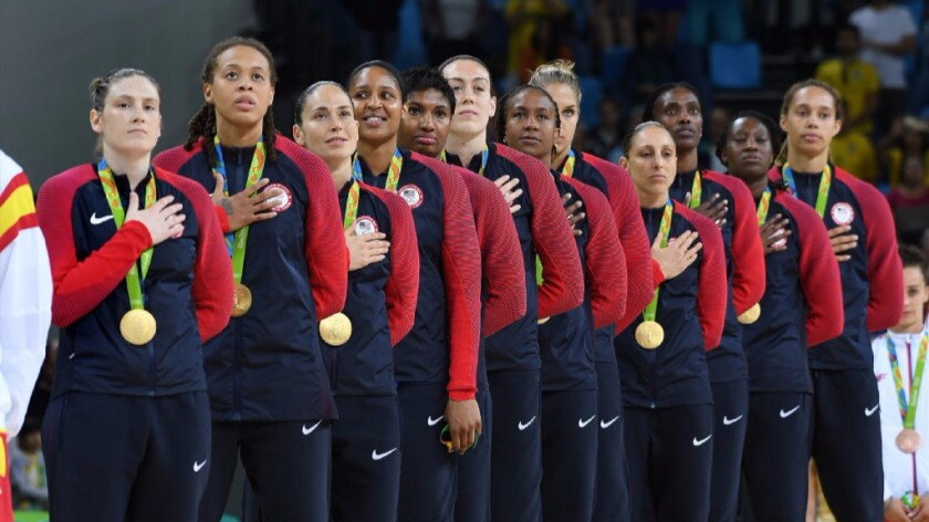 The United States women's basketball team stands during the national anthem after defeating Spain, 101-72, to win the gold medal at the 2016 Summer Games.