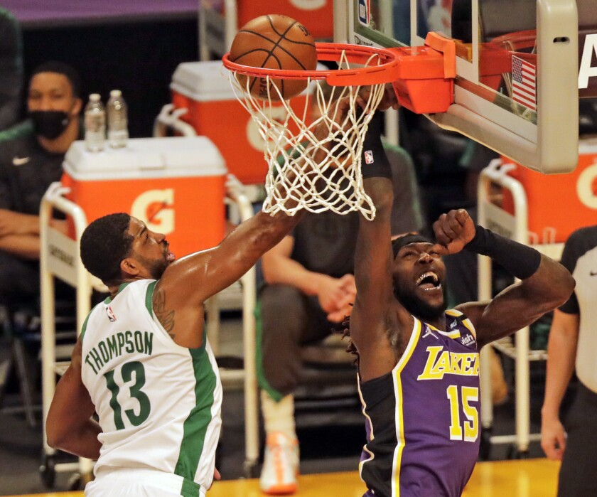 Lakers center Montrezl Harrell scores on a layup against Celtics center Tristan Thompson in the first quarter.